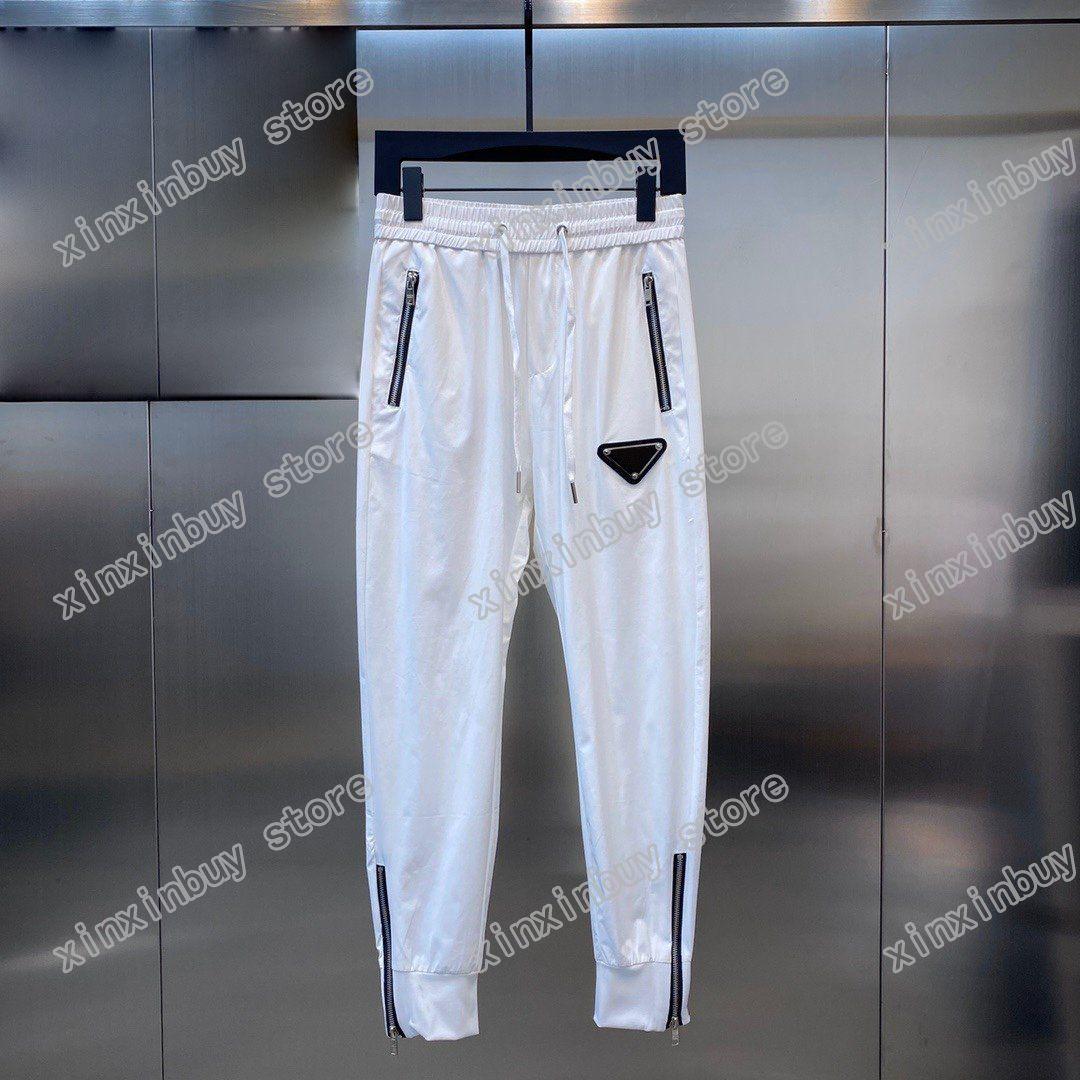21SS Mens Designer Pants Paris Triangolo Etichetta Triangolo Stampa Zipper uomo Pant Casual Letters Pantaloni Khaki Blu scuro