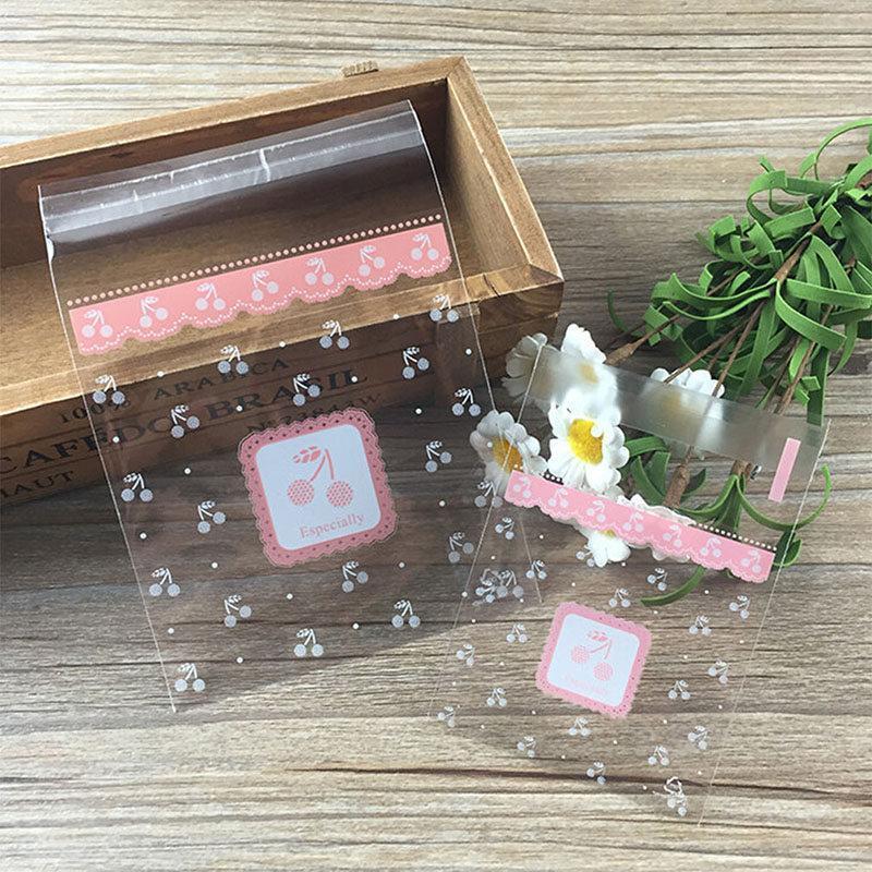 Cadeau cadeau 100pcs Clear Pink Cerisier Candy Sacs Cookie Sacs De Mariage Anniversaire Artisanat Auto Adhésif Plastique Biscuit Packaging Sac
