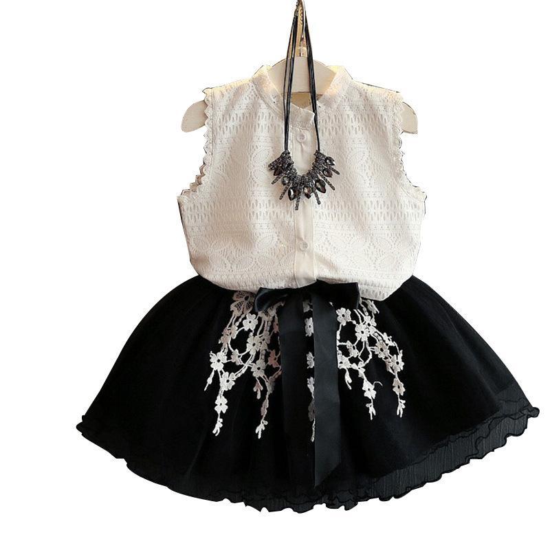 ملابس الأطفال مجموعات الفتيات الصيف أكمام الدانتيل قميص أبيض أعلى + الدانتيل الأسود توتو تنورة الطفل أزياء قصيرة التنانير 3-8 سنة 2 مجموعة ملابس الاطفال