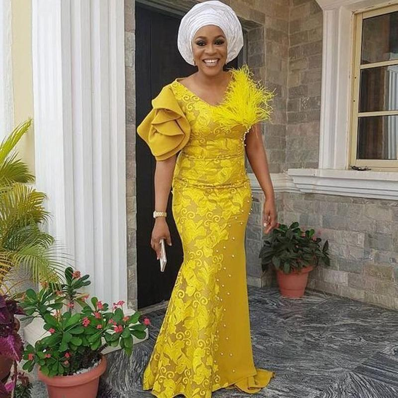African Mermaid Lace Prom Dresses 2020 Yellow Pearls Long Evening Gowns Fshion Aso Ebi Feather Formal Party Plus Size Lace Up