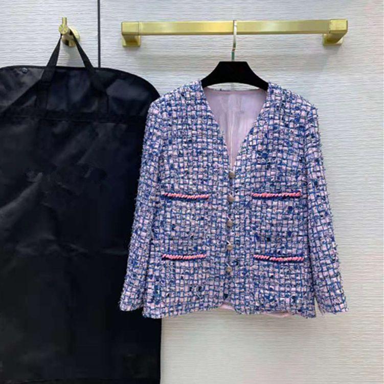 Desgaste de las mujeres europeas y americanas 2021 Invierno La nueva chaqueta de tweed de moda con cuello en V de manga larga con bolsillos de un solo pecho