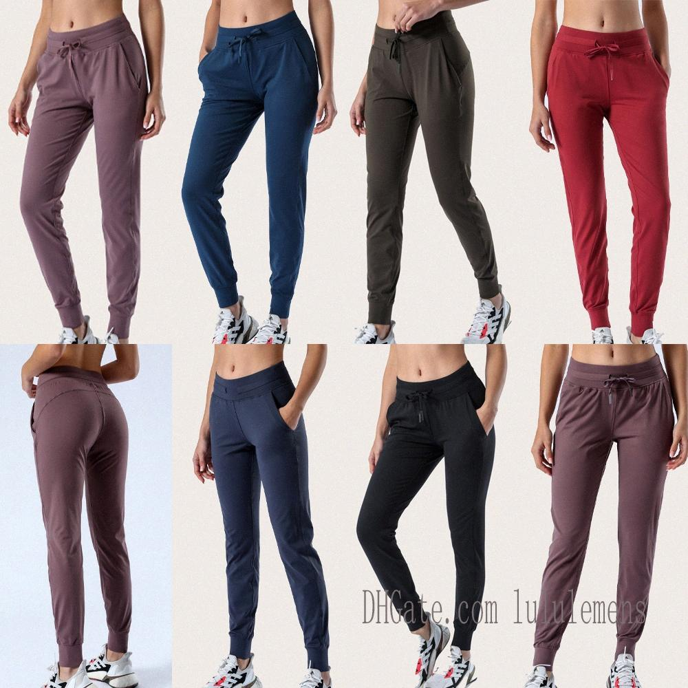 Tissu Yoga Tissu de Yoga Sport Joggers Pantalon Pantalon Lu Femmes Cuisson Cordon Tunstring Fitness Pantalon de transpiration avec deux poches latérales Stylelhet #