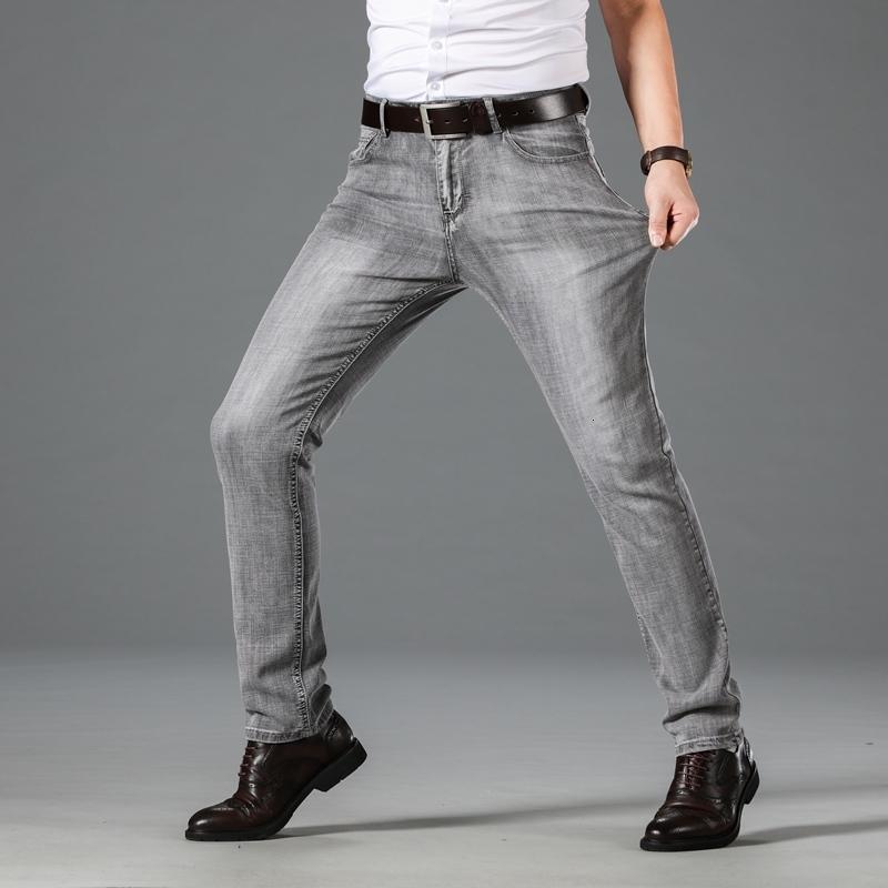 Jeans maschili 2021 Autunno Denim Grigio / Blu Fashion Casual Business Jeans in tessuto elasticizzato di alta qualità Pantaloni da uomo rettilineo regolari