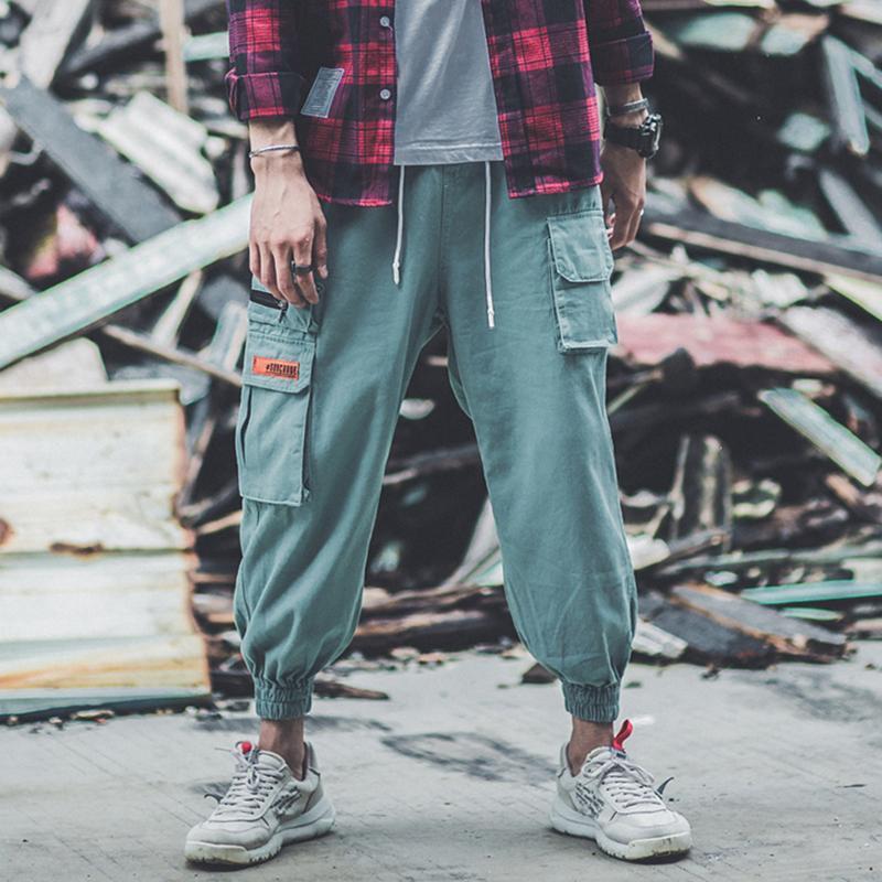 Corredor tasche laterali mimetiche pantaloni sportivi da uomo stilo sciolto calças masculinas
