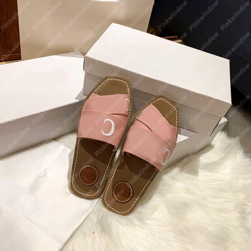 Moda Mujeres Diapositivas Sandalias planas Mule Woody Mule en lienzo Espadrille Diseñadores de Lujos Designers Sliders Sandalias Sandale Designer Shoes con caja 2104061L