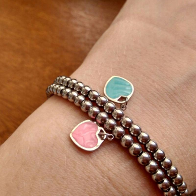 Logo Braccialetto di lusso Braccialetto Braccialetto Donne Strandini in acciaio inox Catena a disposizione Regali per Accessori Girlfriend Pink Rosso Verde Vendita all'ingrosso