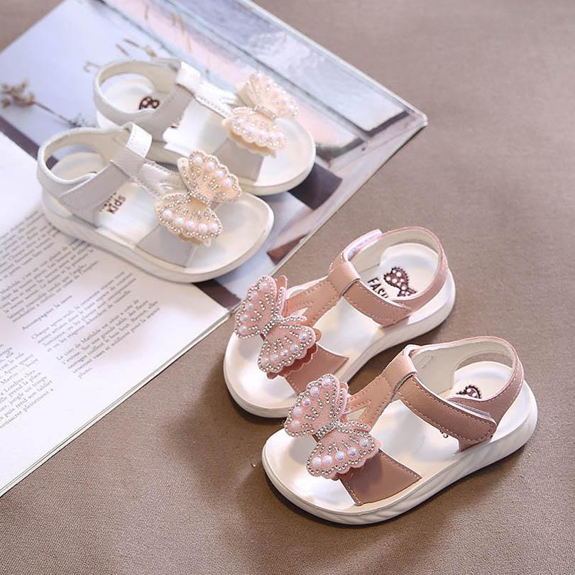 طفل الصنادل أطفال أحذية الفتيات صندل الصندل الرضع الأحذية شاطئ الأطفال اللؤلؤ القوس فراشة الأميرة حجر الراين طفل ارتداء B6999