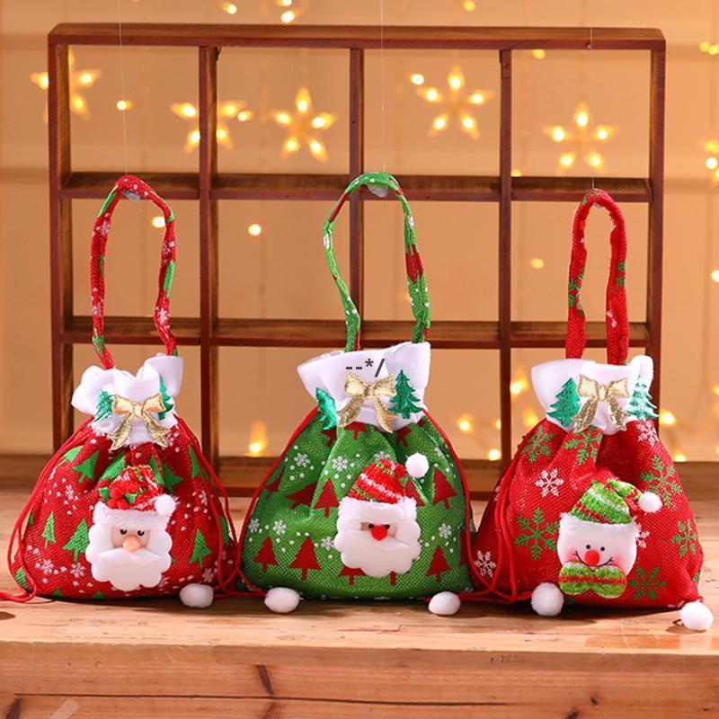 Navidad cordón de souvenir bolsa de souvenir santa claus caramelo saco árboles de Navidad patrón de muñeco de nieve patrón colgante decoración sacos bolsa de almacenamiento doméstico NHE9095