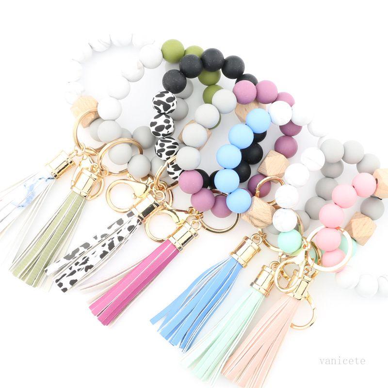 Bracelets de perles de silicone de mode Hêtre Tassel Clé Chaîne Pendentif Bracelet en cuir Bijoux pour femmes 14 Style T500606