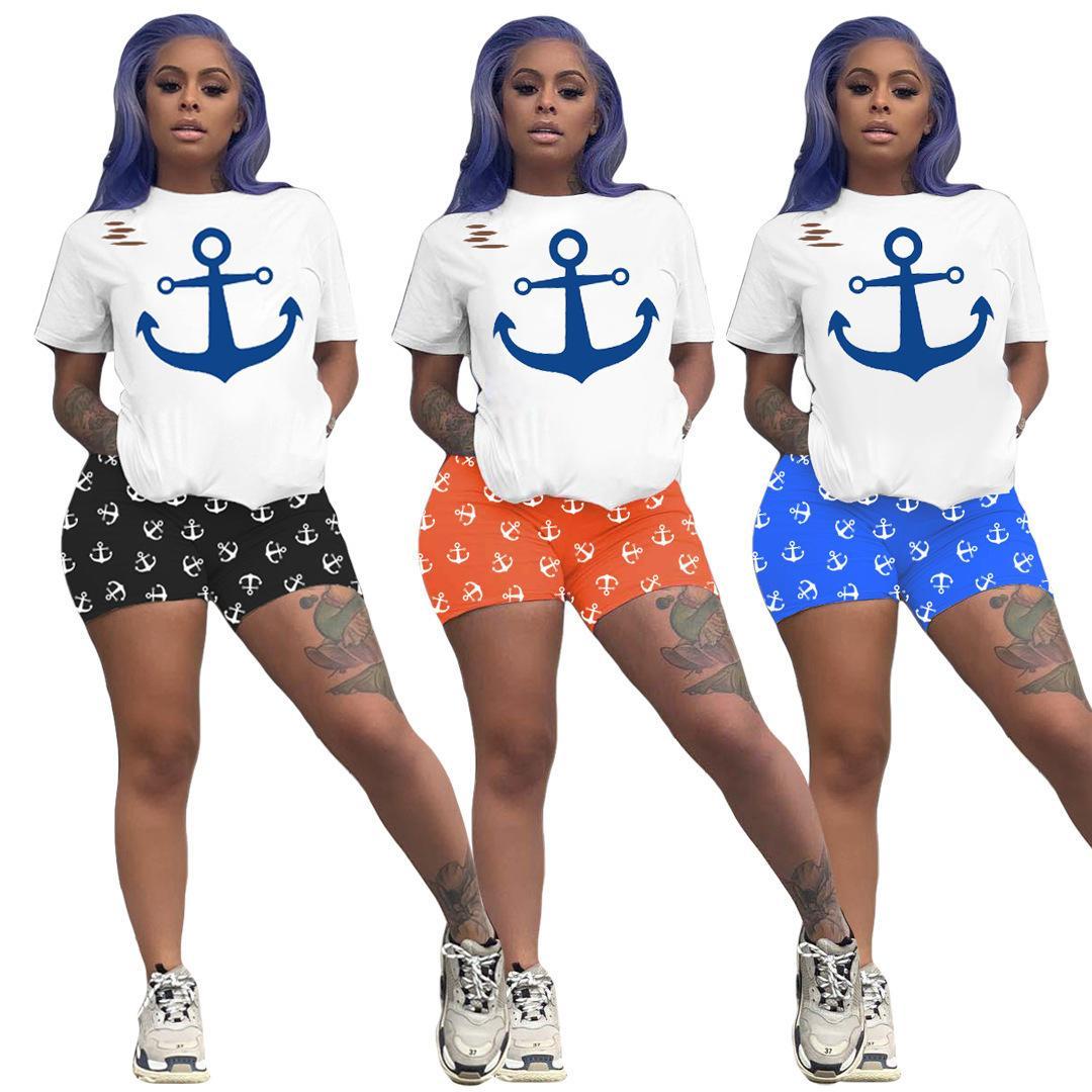 Дизайнерские женщины 2 штуки наборы трексуиты летние наряды плюс размер S-2XL бега трусного костюма с короткими рукавами футболки + шорты спортивная спортивная спортивная одежда