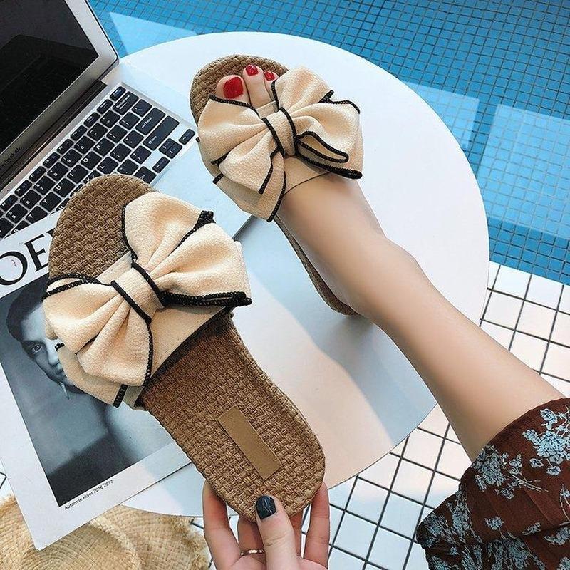 Damas zapatillas planas de verano Moda de verano PU PU Cuero antideslizante Mujeres Zapatos Coreanos Bowknot Playa al aire libre