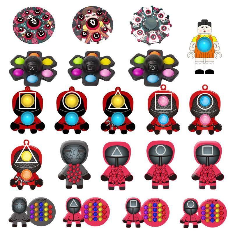 キーホルダー大人の子供の自閉症者のための強盗の強盗のストレスのためのFidget Toys Squid Game Game Partyシリコーンプッシュバブル感覚リリーバーストレス
