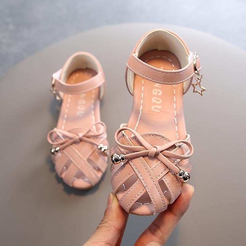 بنات 2021 الصيف الصنادل Baotou جوفاء الأميرة الأحذية القوس لينة أسفل شاطئ عدم الانزلاق