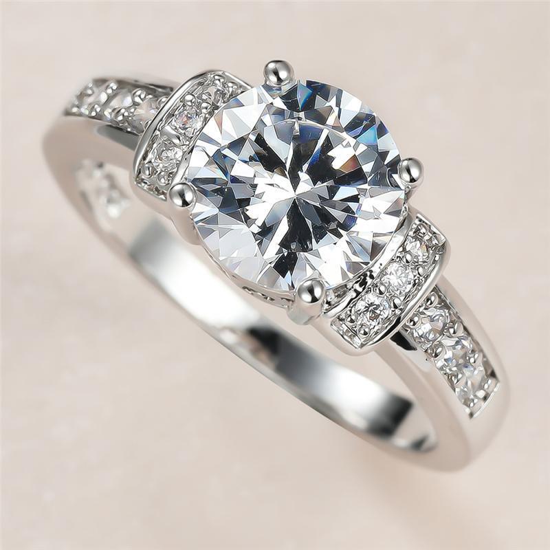 الكلاسيكية الإناث الأبيض كريستال حجر الدائري سحر الفضة لون خواتم الزفاف للنساء لذيذ العروس جولة الزركون المشاركة