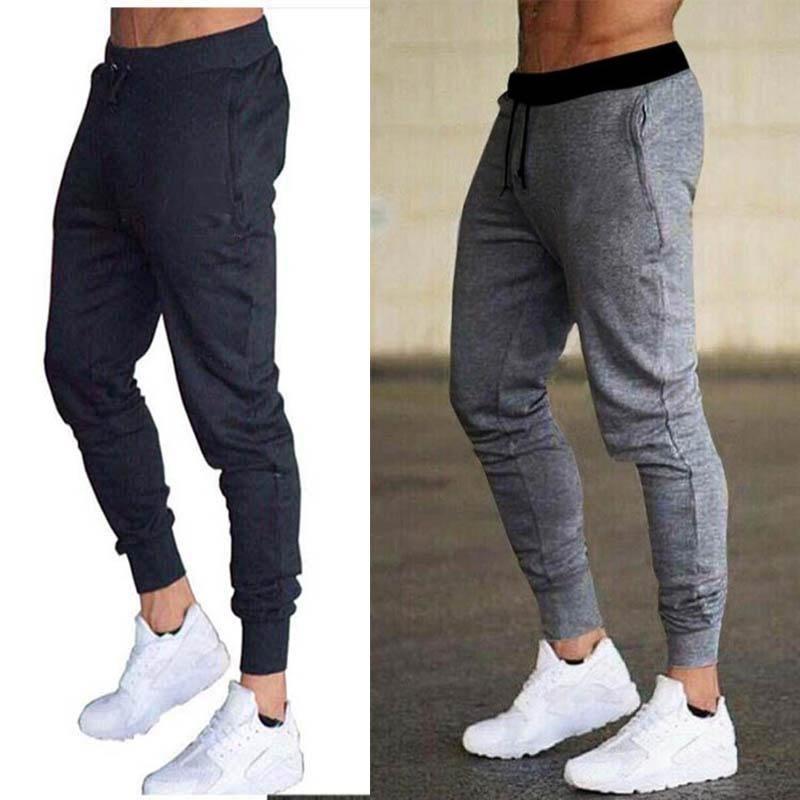Nuevo primavera otoño marca gimnasios hombres joggers pantalones joggers hombres pantalones deportivos ropa deportiva el pantalón de culturismo de alta calidad