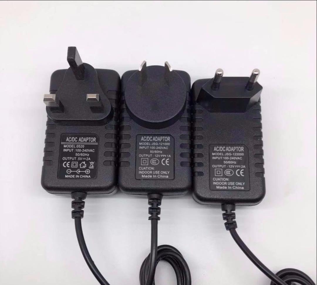 electronic components power adapter router 9V1A Adaptateur secteur Australian regulatory Netzteil display Adattatore di alimentazione Cuibheoir Cumhachta