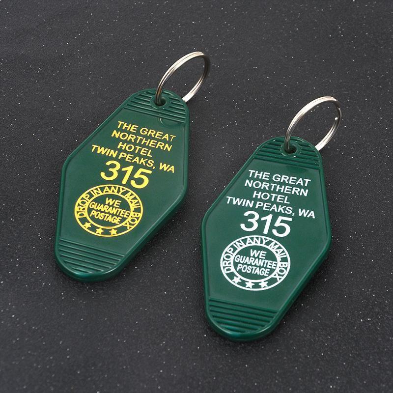 Schlüsselanhänger TV Show Twin Peaks Keychain Green Prismatic Acryl Schlüsselanhänger Der Große nördliche El Zimmer # 315 Geschenk für Fans