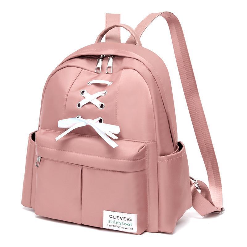 Bolsas al aire libre 2021 Mochila Oxford Paño Simple Arco High School Studed Student Bag Amplio Capacidad Viajes Mujeres