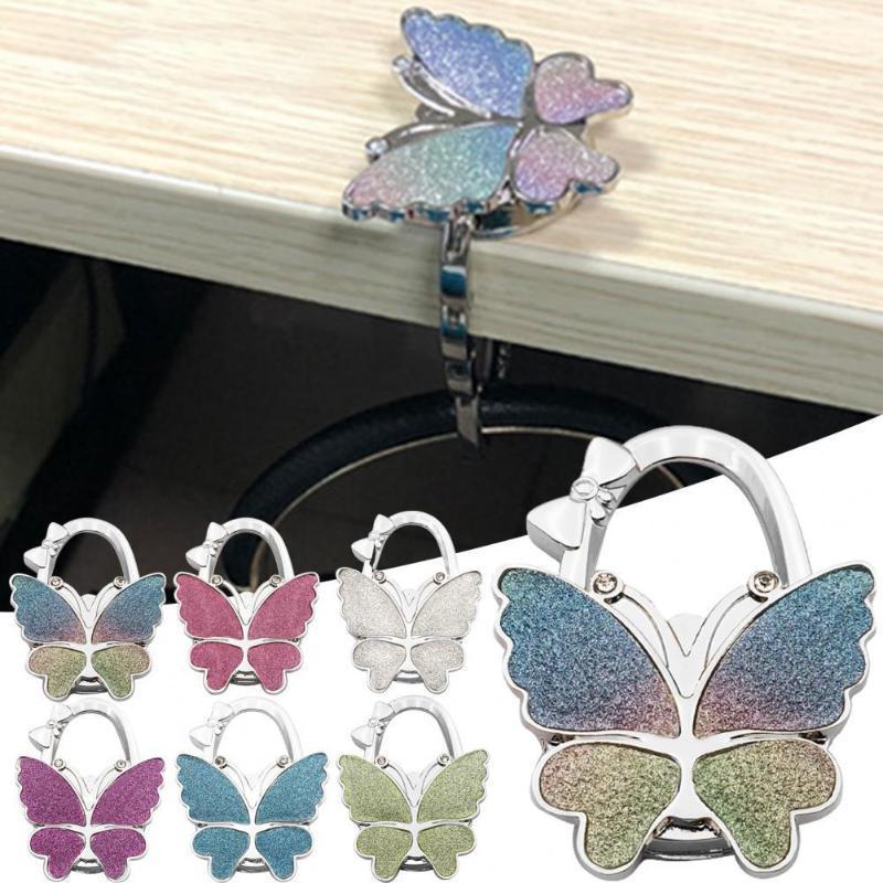 Ganci rails borse handbag gancio pieghevole farfalla forma tavola gancio portatile portafoglio borsa portabulto borsa fibbia forniture per la casa