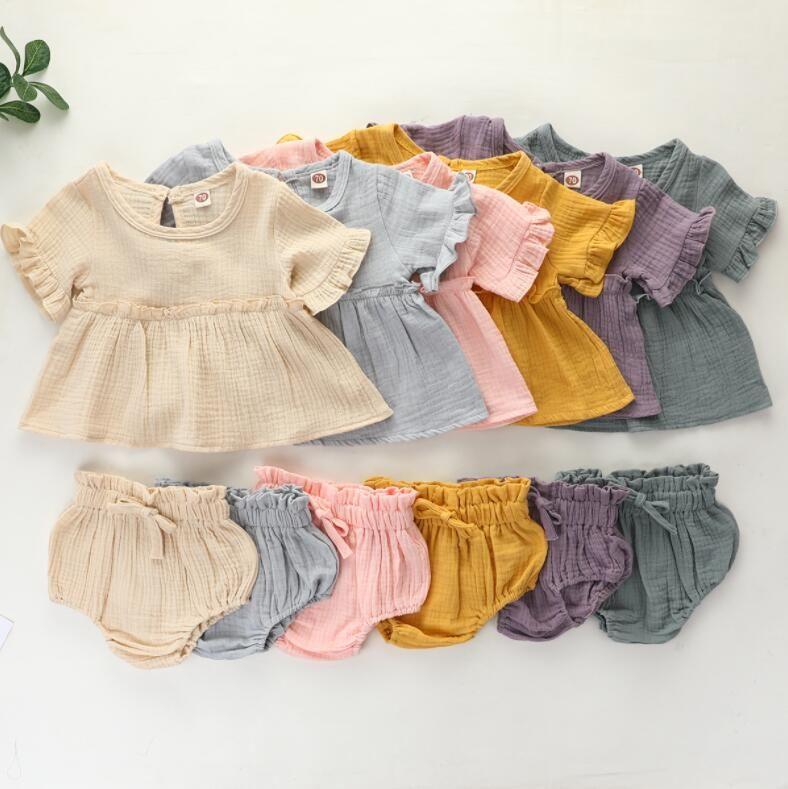 INS فتاة ملابس الطفل قطعتين مجموعات الصيف بلون س الرقبة الكشكشة + قصيرة 100٪ قطن ملابس الطفل مجموعة