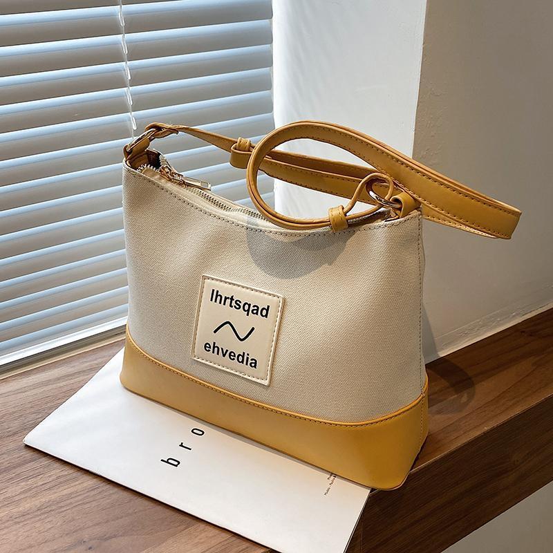 틈새 디자인 가방 여성 2021 패션 캔버스 메신저 양동이 숄더 덤불 너비 : 28cm 가방