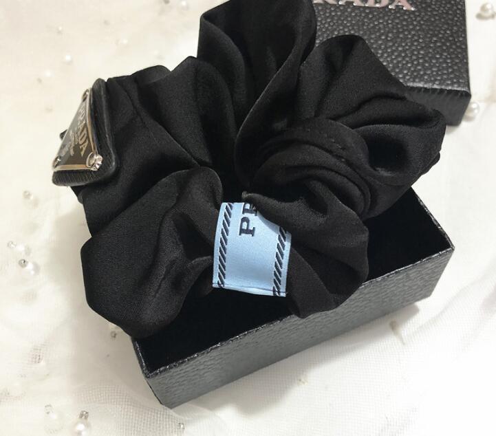 Mujeres Diseñador letra Cabello Banda de goma Bowknot Letra Elástica Cuerda Cuerda Ponillo de Ponytail Titular de Lujo Accesorios para el cabello GC166