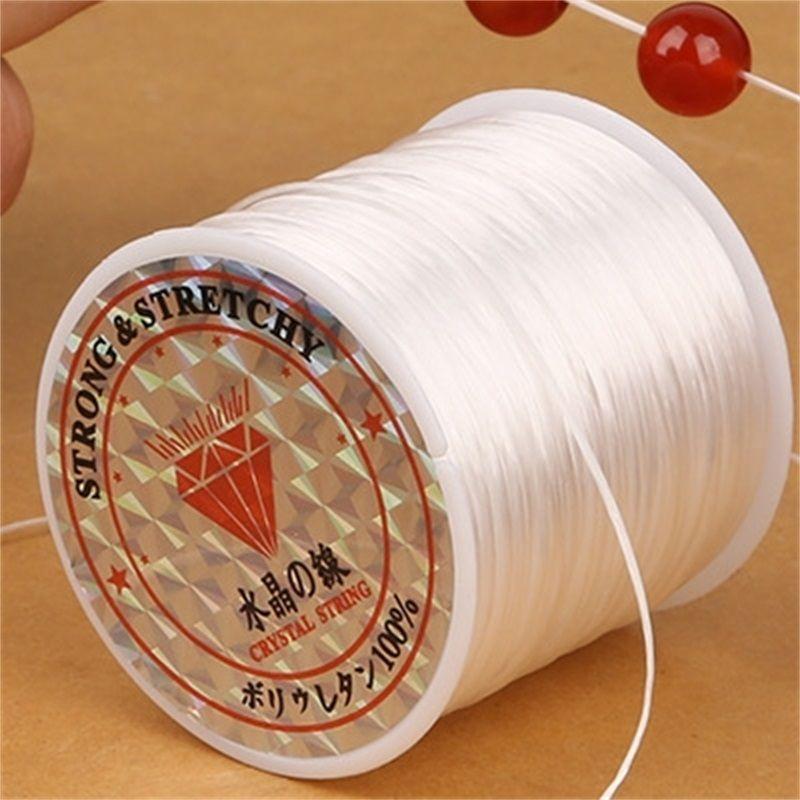 50m / rouleau 0.7mm élastique rond de ligne de cristal de filetage en nylon en caoutchouc cordon extensible pour bijouterie bracelet de perles 14 couleurs 1707 Q2
