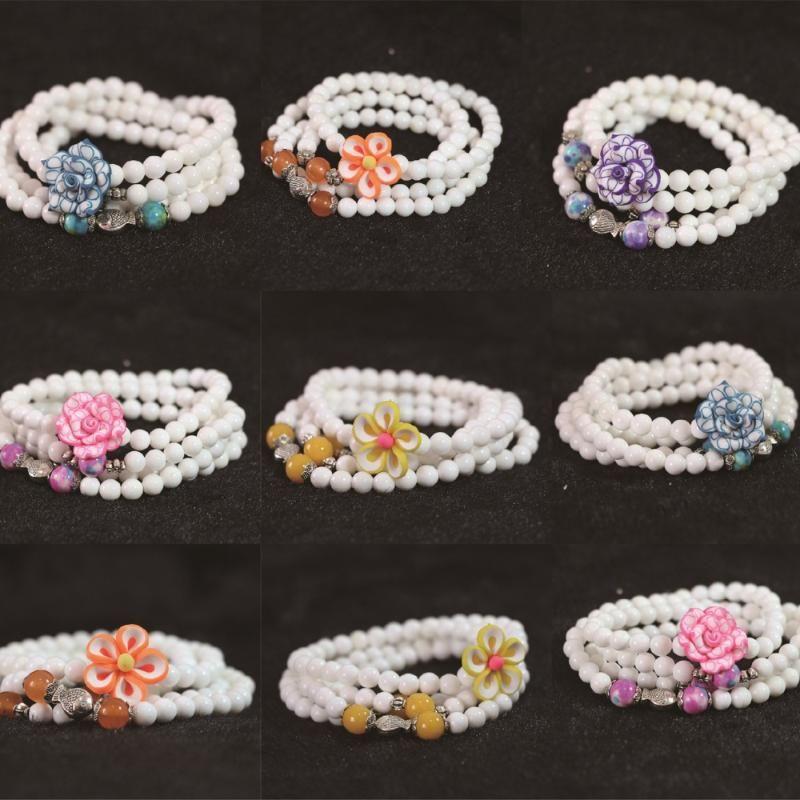 Braccialetto multistrato bianco di tridacna 6mm 108 perline con le donne colorate dei fiori Donne del pendente FAI DA TE B789 in rilievo, fili