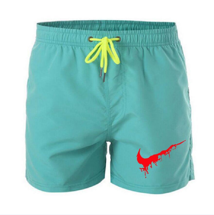 2021 Fashion Men's Traspirable Stampa uomo estate in cotone Beach Brevi uomini selvaggi per il tempo libero Singolo Solid Cargo Shorts Plus Size S-XXXL