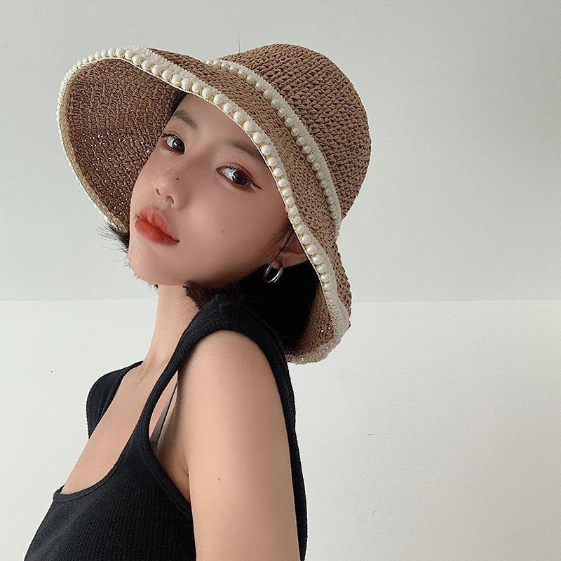 Sombreros de ala ancha Perla de las mujeres Decorada Cubo de verano Paja Protección solar Playa Holiday Moda casual Female Caps 2021