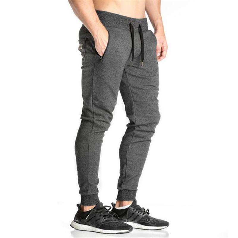 Hot New Jogger Pants Hombres Fitness Culturismo Gimnasio Pantalones Para Corredores Ropa Otoño Pantalones de sudor de alta calidad