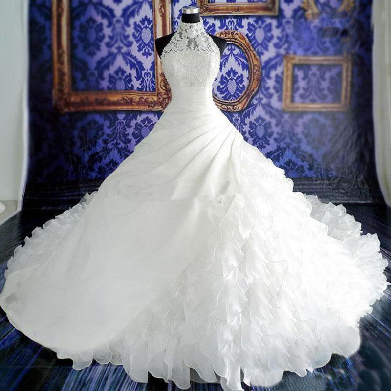Discount High Neck Illusion Halter Wedding Dresses Exquisite Beaded Pearls Crystals Lace Appliqued Top Ruffles Skirt Long Cathedral Train Bridal Gown