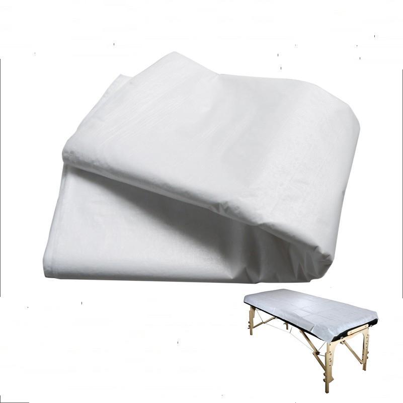 Tek kullanımlık beyaz masaj çarşaf düz masa örtüsü su geçirmez 10 yaprak bir paket