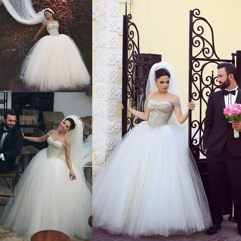 Discount 2016 Mhamad Ball Gown Wedding Dresses Off Shoulder Crystals Beaded Tulle Bridal Gowns Beading Straps Floor Length Wedding Gowns Custom Made A