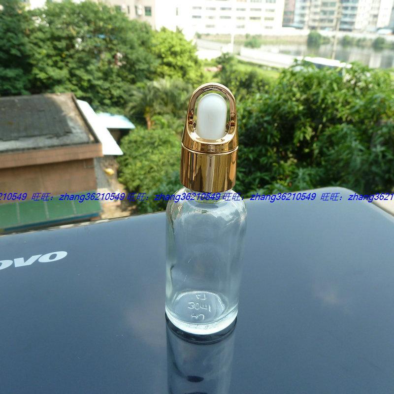 30ml 투명 / 투명 유리 에센셜 오일 병 반짝이는 골드 스포이드 캡이 달린 알루미늄 바구니. 에센셜 오일 용기