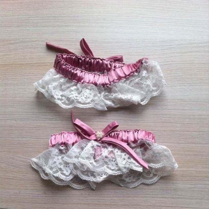 Op maat gemaakte mooie bruiloft garters in aandelen verkoop 2015 met glanzende parel en mooie donkerroze strik ivoor kant bruidsgezinnen