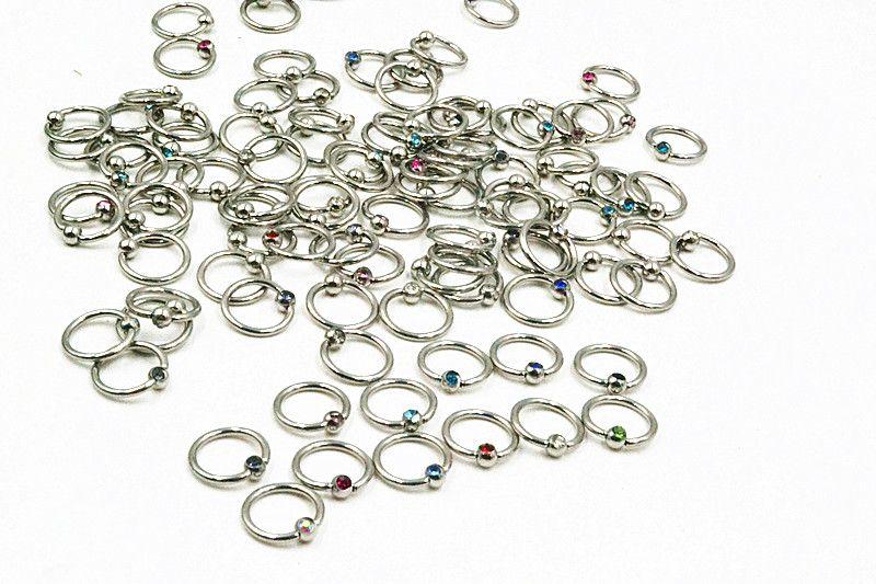 LOT100pcs 16G ~ 1.2mm Cercle Gems Nez clicker Bague Nez / Oreille / Anneau De Mamelon Utiliser Mulit Anneau corps piercing bijoux BCR Mix Couleurs