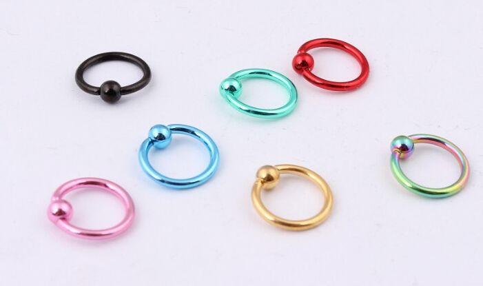 All'ingrosso-OP-Mix Colore 50pcs 16G titanio anodizzato in rilievo Bead Ring sopracciglio capezzolo Labret Lip Nose Ring Piercing gioielli corpo spedizione gratuita