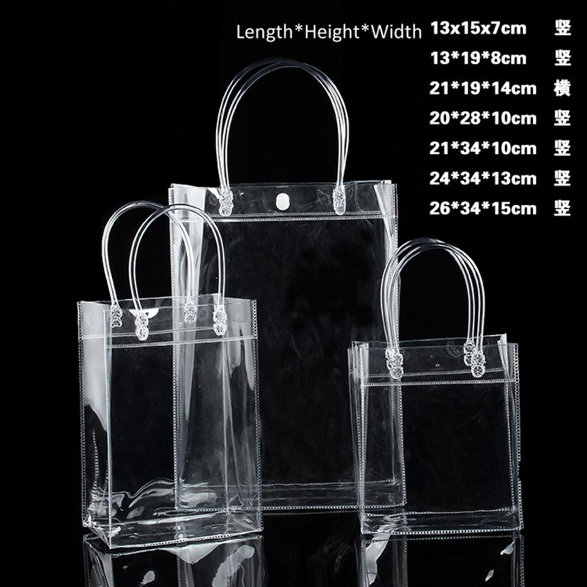 2018 Limitata 10 pz / lotto Trasparente Pvc regalo Tote borse con l'anello della mano, in plastica trasparente borsa, sacchetto di indumenti richiudibile, spedizione gratuita