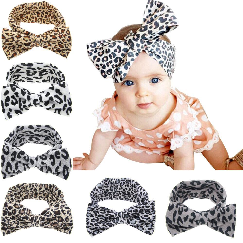 Neue Mode Baby Mädchen Leopardenaufnahme Blumen Bowknot Stirnband Elastische Stretch Große Bogen Haarband Kinder Haarschmuck 25pcs /