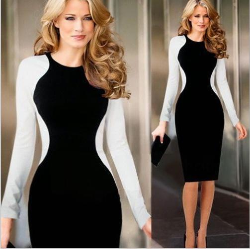 La estrella de las mujeres de comercio exterior europeo y estadounidense con el vestido de primavera golpeó el color de costura era falda lápiz de paquete delgado de la cadera