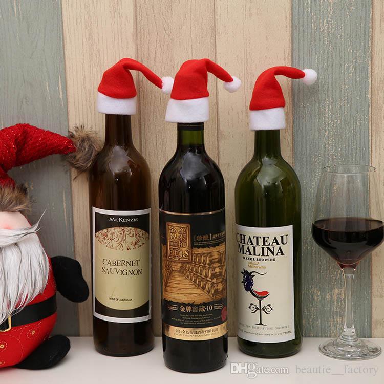 50pcs Santa Hat Wine Bottle Cover Cover Rouge ChristMax Mignon Favoris Favoris Fournitures Champagne Table Décor Noël Décoration de la maison de Noël