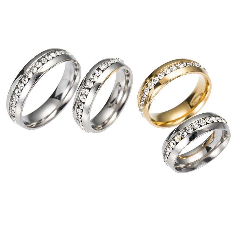 Commercio all'ingrosso 100pcs Mix argento e oro placcato una fila strass in acciaio inox anelli di nozze banda di gioielli