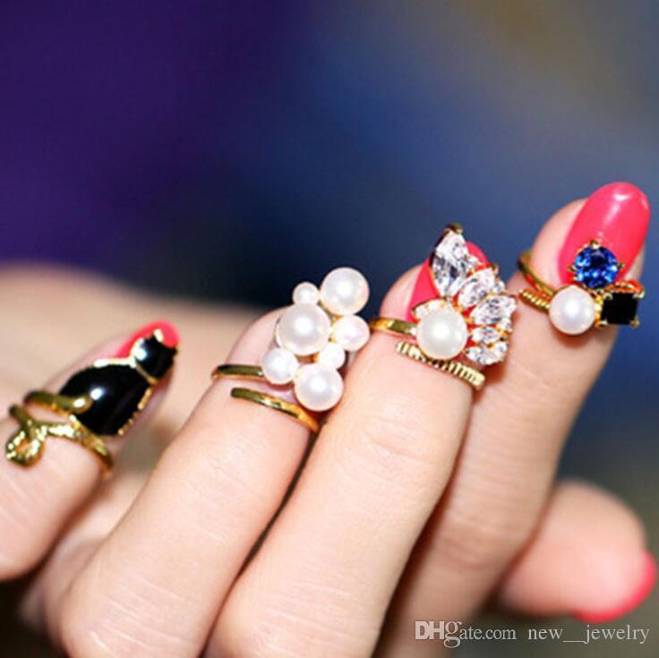 Anelli della barretta dell'anello di chiodo dell'anello del dito della perla del Rhinestone della perla di cristallo sveglio di fascino di modo