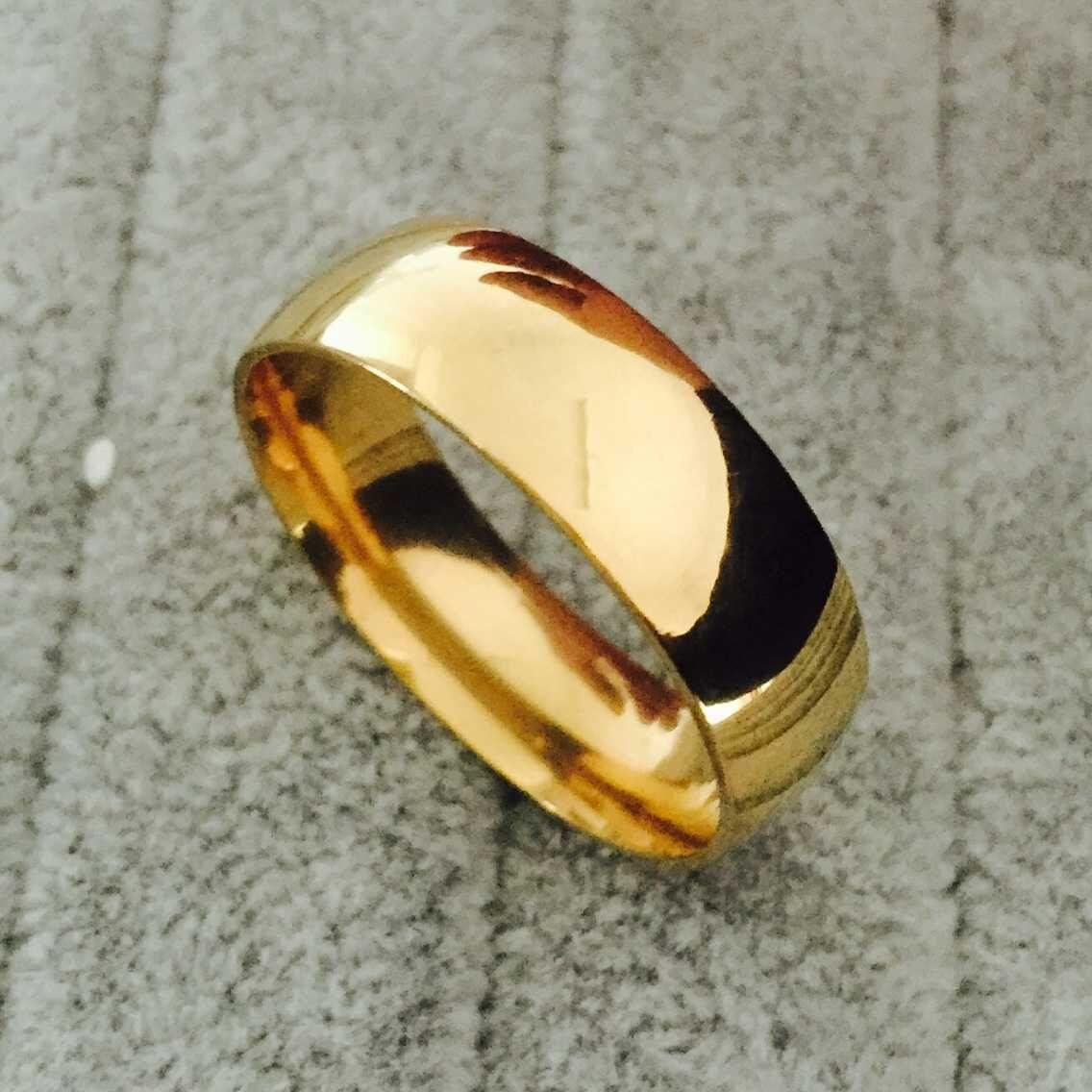 This is a picture of High Polish Wide 42mm Men Wedding Gold Rings Real 42K Gold Filled