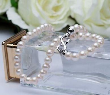 Großhandel 10- 11mm Runde Südsee weiße Perlenkette 18 Zoll Silber Verschluss