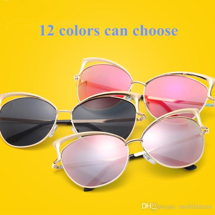 lunettes de soleil de concepteur pour les femmes mode européenne oeil de chat lunettes de soleil dames lunettes de soleil en gros nouveau cadre en métal creux 557