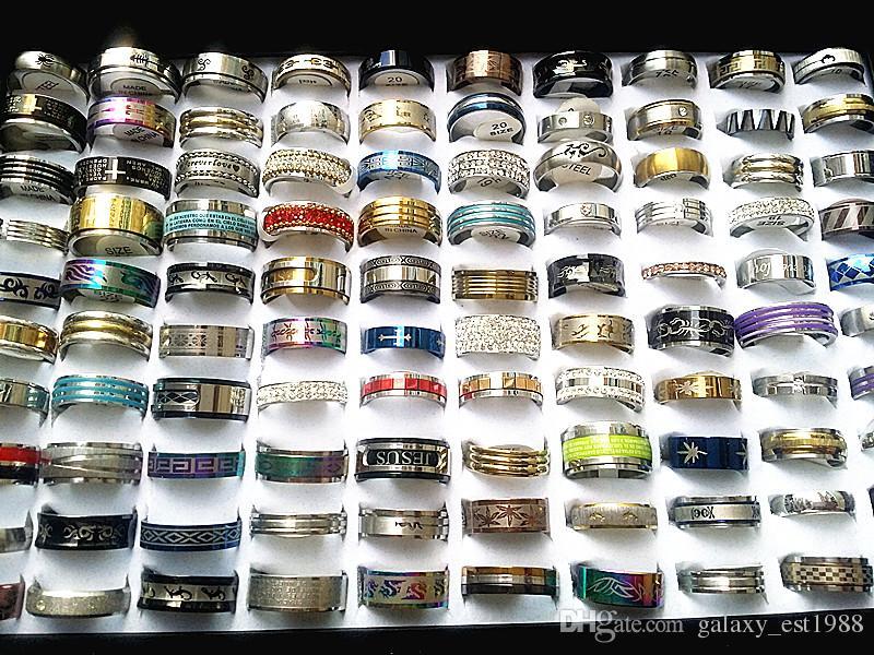 commercio all'ingrosso disegni misti 100pcs in acciaio inox delle donne degli uomini anelli di liquidazione dei monili di modo di vendita prezzo di alta qualità a buon mercato con una scatola