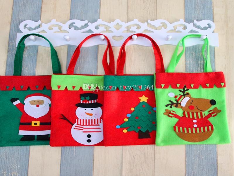 20pcs / lot Trasporto veloce nuovo Creativo Babbo Natale Maniglia Sacco Sacchetto regalo di Natale Decorazione 4 stili