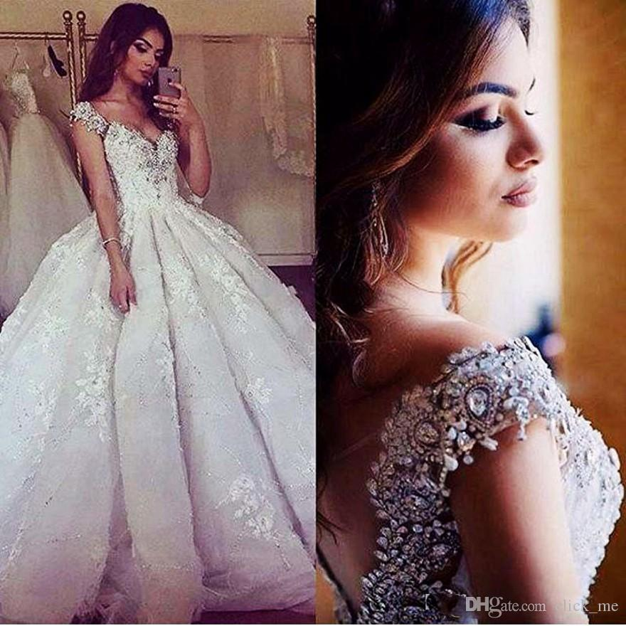 Luxury Ball Gown Wedding Dresses 2017 Modest Beaded Collar Lace Appliqued Vintage Bridal Dress Caped Sheer Back Crystals Wedding Gowns